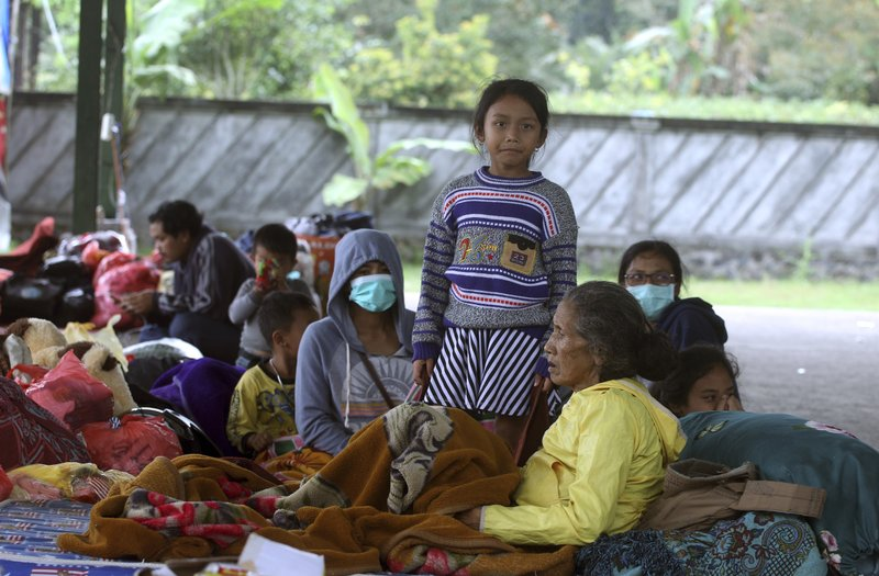 Villagers rest at an evacuee camp in Rendang, Bali, Indonesia, Monday, Sept. 25, 2017. More than 35,000 people have fled a menacing volcano on the Indonesia tourist island of Bali, fearing will erupt for the first time in more than half a century as increasing tremors rattle the region. (AP Photo/Firdia Lisnawati)